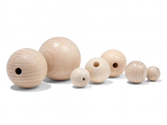 Beechwood ball, partially drilled, raw