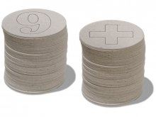 Grey board discs with punched numbers and letters