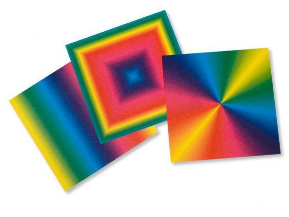 Origami folding rainbow-coloured paper